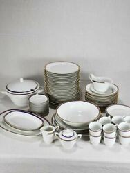 Vintage Dinnerware With Blue And Gold Trim