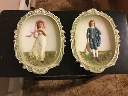2 Porcelain wall plaques Pink Girl and Blue Boy.....made by Lefton....vintage