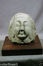 Ancient Asian Stone Face On Wooden Base