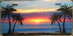 BEACH AND PALM TREES AT SUNSET METAL NOVELTY LICENSE PLATE TAG $14.99