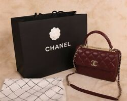 Authentic CHANEL Flap Bag With Top Handle Lambskin Leather and Gold Tone Metal