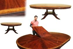 Custom 72 Inch Round Mahogany Dining Table with Self Storing Leaf
