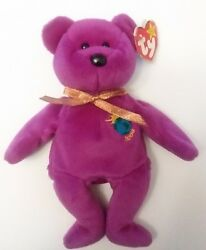 Retired 1999 Millennium Beanie Baby with STIFF GOLD RIBBON in perfect condition.