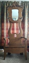 Antique hall seat with mirror and hidden storage seat. Ornate hooks.