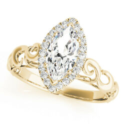 Forever Brilliant Marquise Moissanite In A Filigree Marquise Halo Diamond Ring
