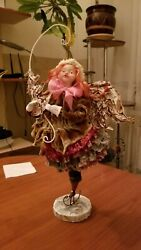 DOLL ANGEL with face up with a christmas tree. Wireframe textile papye-mashe