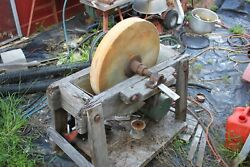 antique sharping wheel large stone in water trough for sharping axes swords etc
