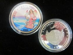 2009 Silver clad Angel of Love coin with Heart Shaped Crystal in capsule w COA