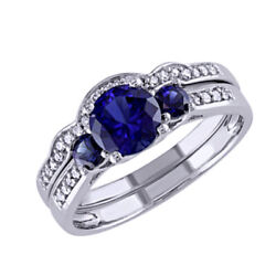Created Blue Sapphire And 1/6 Ct Diamond Wedding Set Ring In 10k White Gold