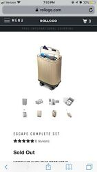 New In Box Rollogo Champagne Colored Luggage. Sold From B8ta.