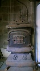 Antique Wood Burning Stove Round Oak Duplex Cast Iron With Pipes And Accessories