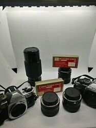 Two Vintage Canon Ae-1 Cameras With 4 Lenses And Camera Bag - Perfect Condition