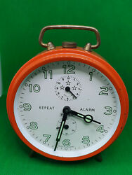 Vintage Peter Repeat Alarm Clock In A Orange Case With A White Face,black Hands.