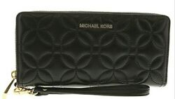 MICHAEL KORS TRAVEL CONTINETAL WRISTLET.. soft quilted leather! $25.00