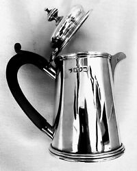 A Queen Anne Style Silver Cream Jug In The Form Of A Coffee Pot. 1911