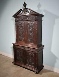 French Antique Renaissance Cabinet In Solid Oak Highly Carved With Faces