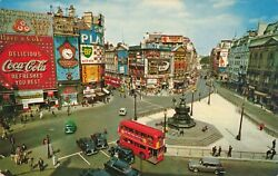Circa 1960and039s Piccadilly Circus London Old Cars Coca-cola Sign Skol Lager