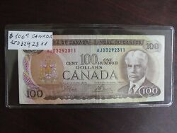 Bank Of Canada 1975 100. Canadian Note Serial Number Ajd3292311 Crown Bouey