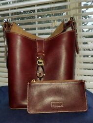 NWT Dooney and Bourke Lily Bucket Leather Bag w zipper bag and key chain  $200.00