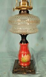 Antique Victorian Embossed Oil Lamp On A Glass And Cast Iron Base