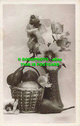 R558798 Flowers In A Vase Next To A Basket Of Fruit. Rotary Photo