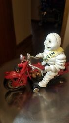 Michelin Man Vintage Cast Iron Toy On Red Motorcycle W/glass Eyes