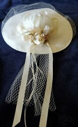 Ivory Sinamay Silk And Net Wide Brim Bridal Hat With Floral And Ribbon Back Accent