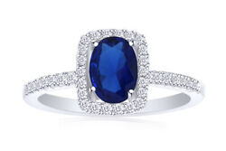 Oval Blue Sapphire And 1/5 Ct.t.w. Diamond Frame Engagement Ring In 14k White Gold
