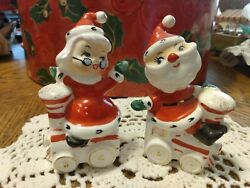 Vintage Christmas Santa And Mrs Claus Riding On Train Salt And Pepper Shakers Nice