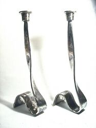 Pair Of Brutalist Plated Silver Distressed Ribbons Of Heavy Metal Candlesticks