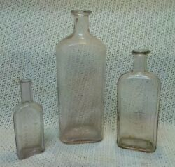 Vintage Lot Of 3 Clear Medicine Bottles. 10 7.5 And 5.5 Tall.