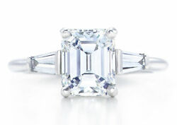 Classic Three Stone Emerald Cut Diamond Engagement Ring With Baguettes