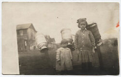Photo Post Card Young Girls With Metal Milk Containers Drying On Post.