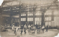 Antique Image Of Group Factory Engineers Hanging Out On Tables. Post Card.