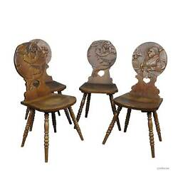 A Set Of Four Carved Whimsy Black Forest Board Chairs Ca. 1900