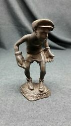 Antique statue of bronze boy goalkeeper sport of the USSR