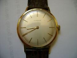 VINTAGE WIND UP JUVENIA 18K  SOLID GOLD SLIM WATCH  RUN AND KEEP TIME