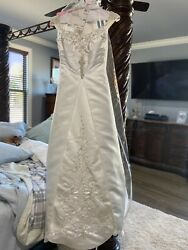 Ivory Wedding Dress With Detailed Beadwork, Long Train, And Matching Veils