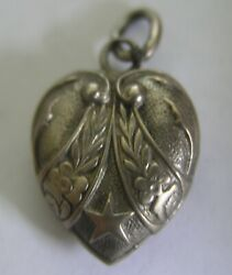 Superb Antique German Silver Puffy Heart Charm Repousse Star And Floral Design