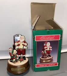 Christmas Musical Figurine- A Tight Fit '' By House Of Lloyd