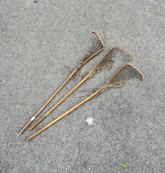 Three Antique Wooden And Leather Lacrosse Sticks.