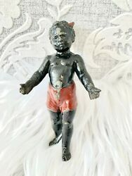 Antique Black Iron Figurine Child Doll Red Shorts Horn
