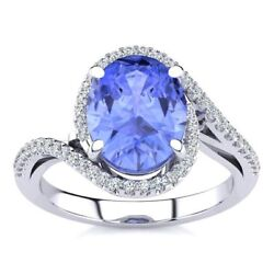 14k Gold 2 3/4 Carat Oval Tanzanite And Halo Diamond Ring - In 3 Gold Colors
