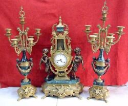 Table clock and couple of chandeliers.