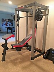 Weider C 875 Home Gym Weight Lifting Rack with weights and speed bag mount.
