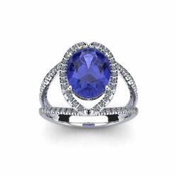 14k Gold 1.75 Carat Oval Shape Tanzanite And Halo Diamond Ring In 3 Gold Colors