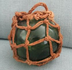 Antique Dark Green Glass Float With Fishing Net Wrap