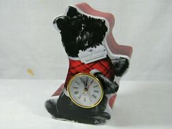 A Quartz Clock from a quot; Scottie quot; Dog doing what they do best Super Clock