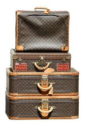 A Collection of Four Louis Vuitton Suitcases with monogram pattern