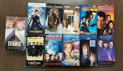Lot Of 11 Vhs Tapes Assorted Movies Action - Titantic / Tombstone / Postman 12